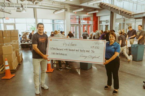 Movement Mortgage raises $15,830 and packs 1,000 Clean Birthing Kits