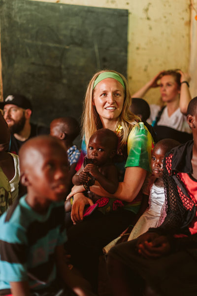 Movement employee with Ugandan students