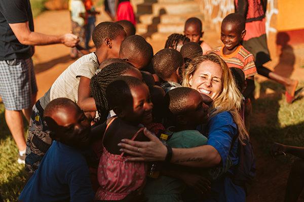 Movement employee with Ugandan children