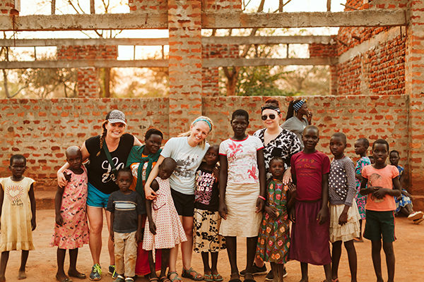 Movement teammates with children in Uganda
